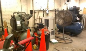 Photo of old equipment in air compression room.