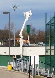 Crane lifting generator on school.